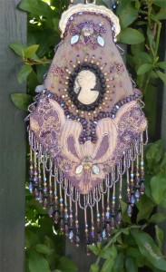 purplecameobag